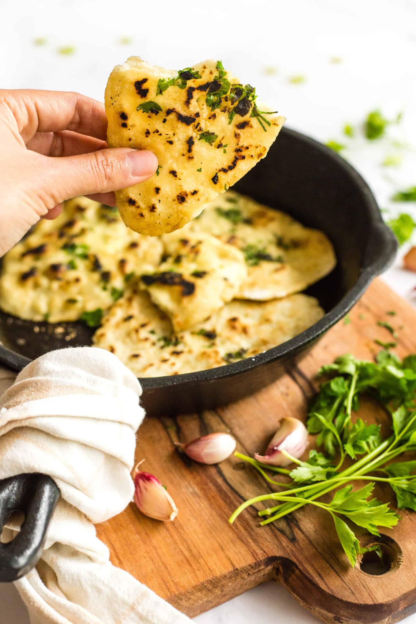 Gluten-free naan bread in a cast iron skillet
