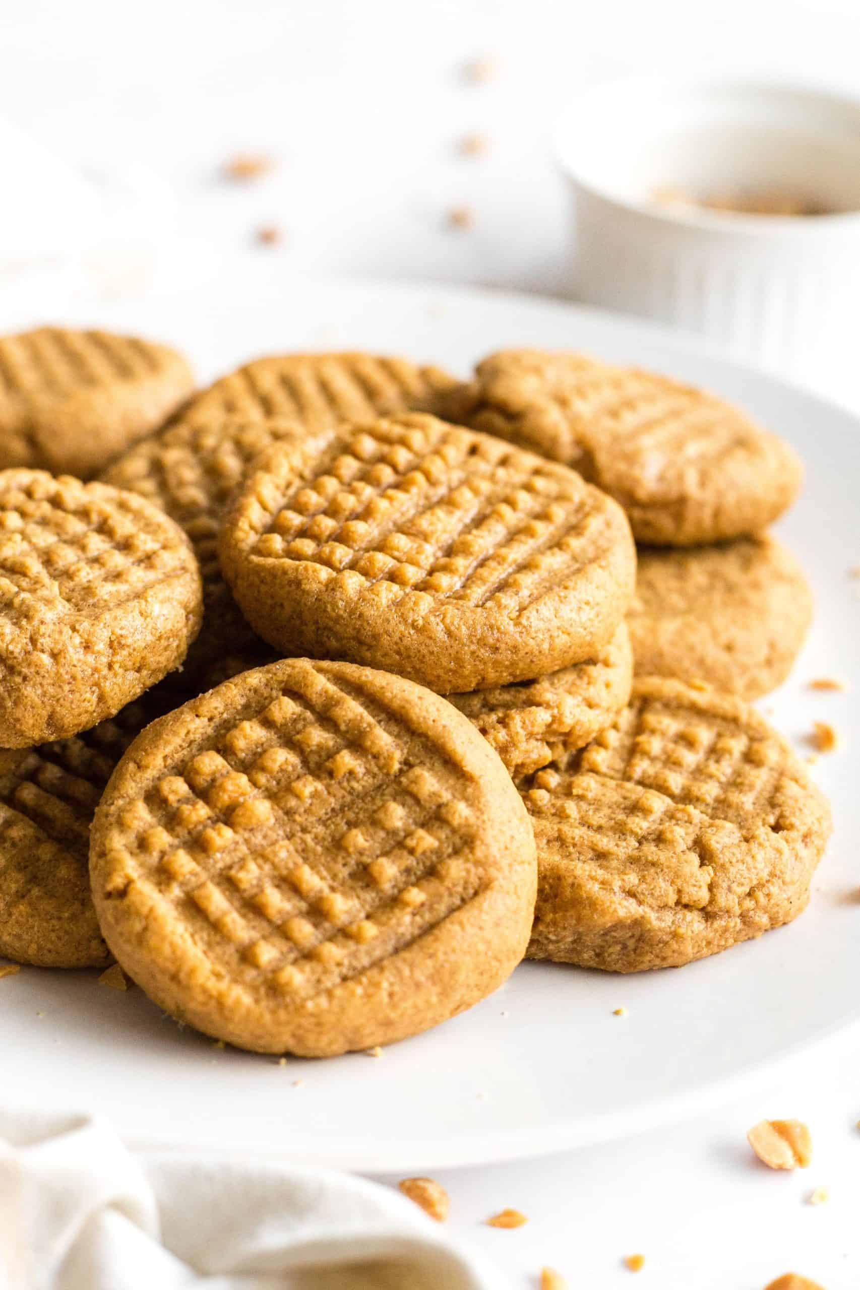 A plate full of flourless peanut butter cookies.