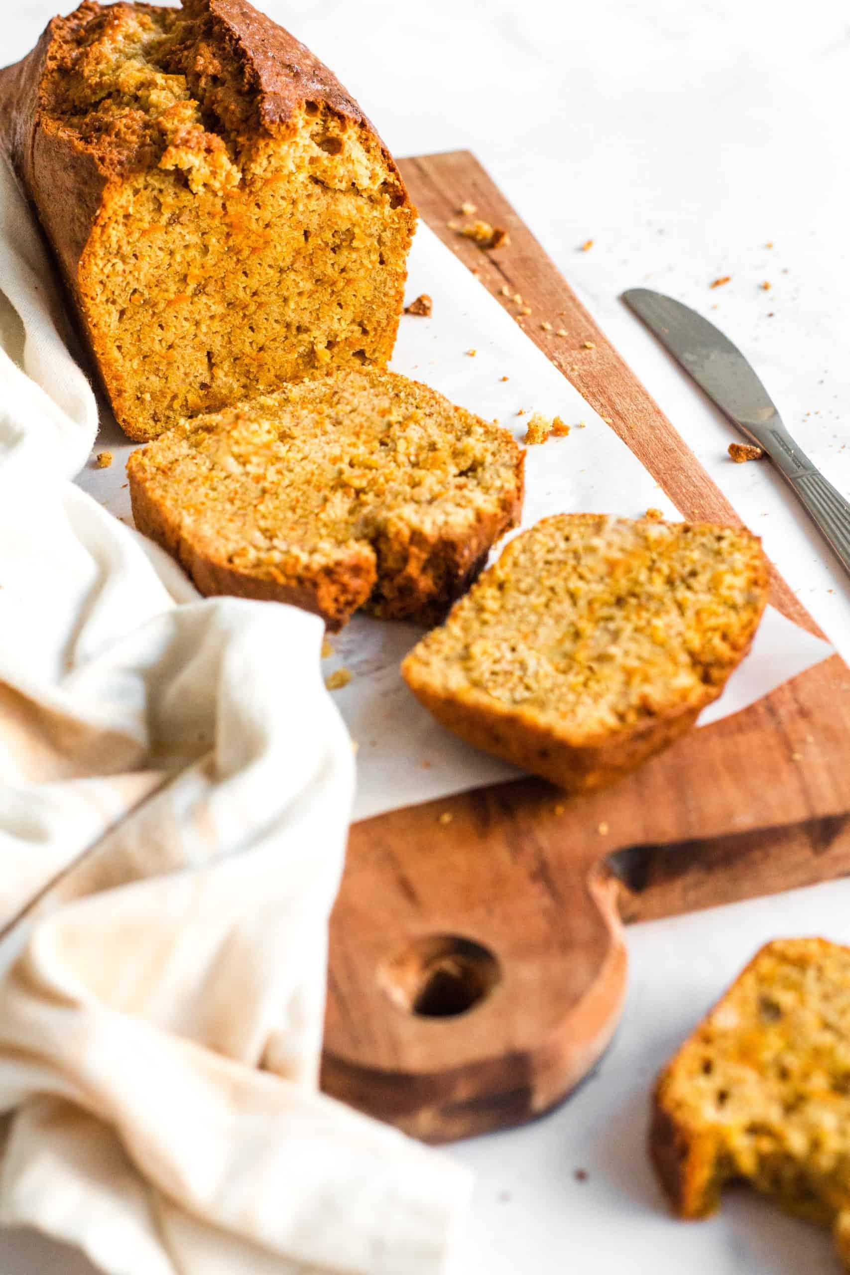 Gluten-free carrot cake bread sliced on a wooden board