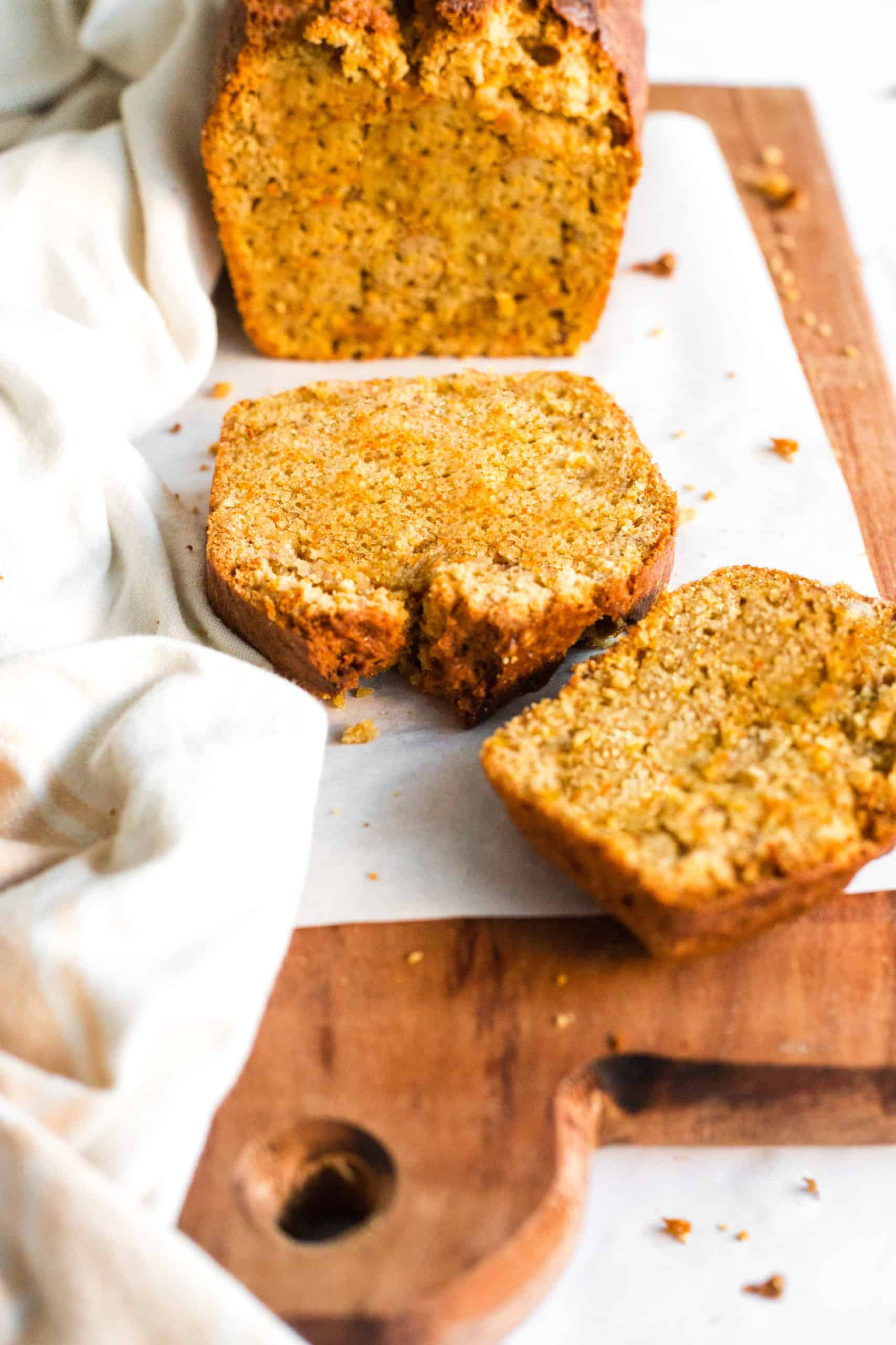 Gluten-free carrot cake bread on a wooden board.