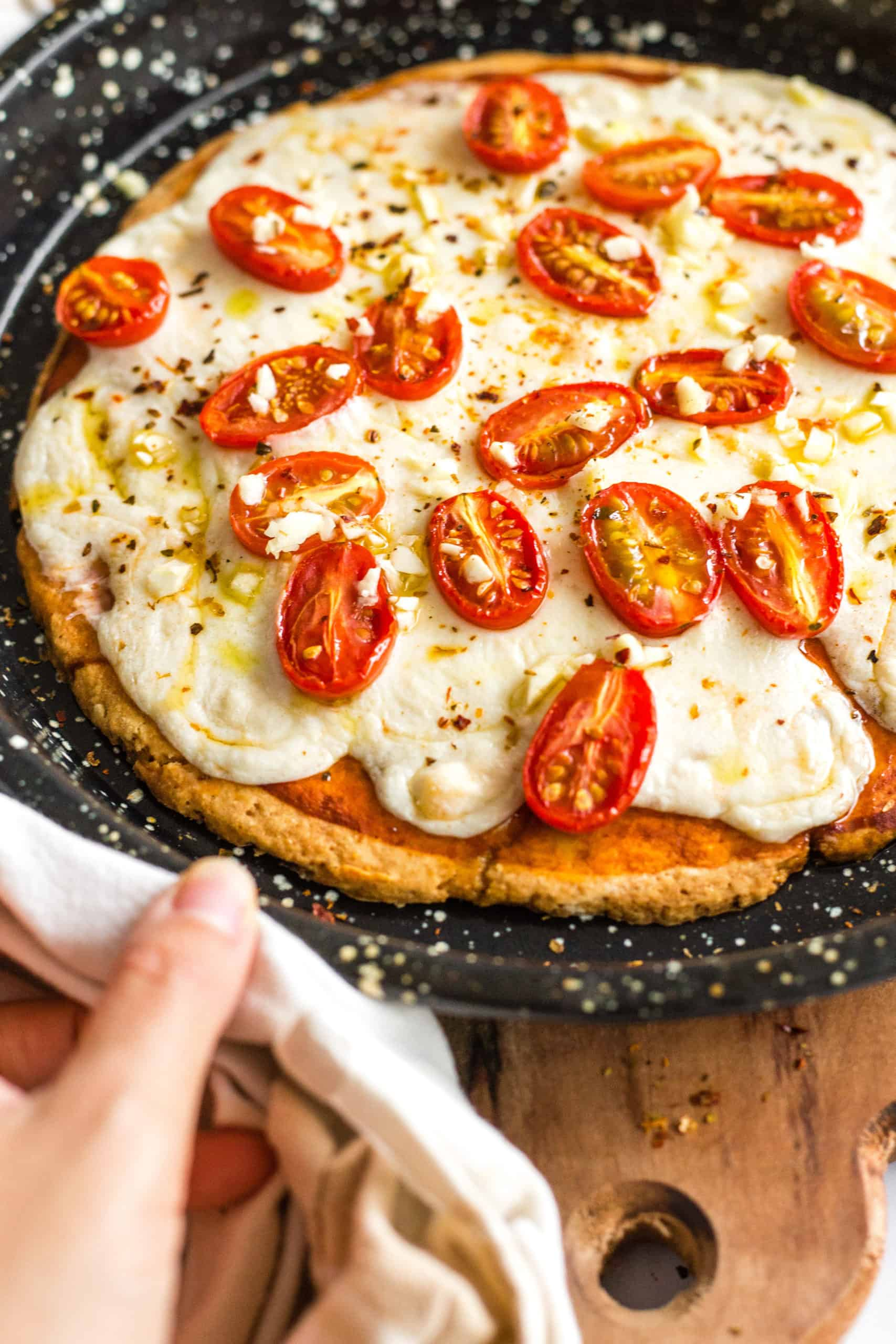 Gluten-free pizza in a pizza pan